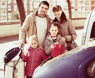 Family with kids with trollers near car Royalty Free Stock Photography