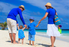 Family with kids walking on tropical beach Stock Photo