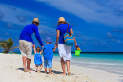 Family with kids walking on tropical beach Stock Images