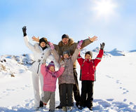 Family with kids in the winter Royalty Free Stock Photos