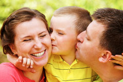 Family kiss Royalty Free Stock Image