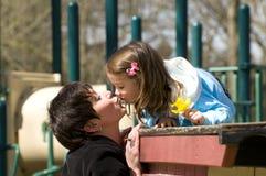 Family kiss stock image