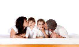 Family kissing royalty free stock photography