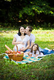 Family kissing Stock Image