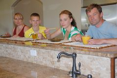 Family in kitchen. Family of four  in modern kitchen Stock Image
