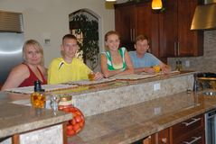 Family in kitchen. Family sit together in kitchen Royalty Free Stock Photography