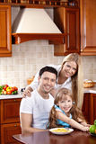 Family in kitchen. Happy family in kitchen look in camera stock photography