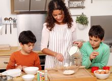 Family in the kitchen Royalty Free Stock Photo