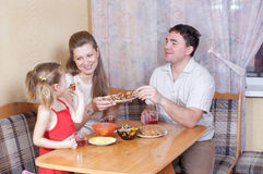 Family on kitchen Stock Photos