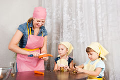 Family in the kitchen Royalty Free Stock Photos