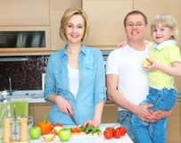 Family on kitchen Stock Image