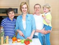 Family on kitchen Stock Photos
