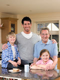 Family in Kitchen Stock Images