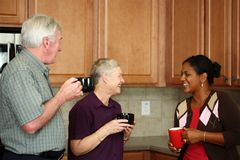 Family In Kitchen Stock Photography