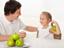 Family in the kitchen with apple Royalty Free Stock Photography