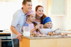 Family in the kitchen with baking ingredients Stock Image
