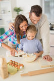 Family In Kitchen Royalty Free Stock Photos