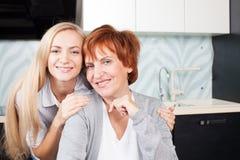 Family on kitchen Royalty Free Stock Photos