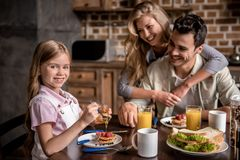 Family in kitchen stock image