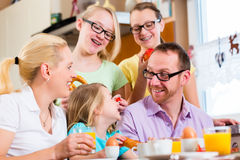 Family in kitchen having breakfast together Royalty Free Stock Image