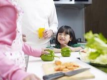 Family in kitchen Stock Photos
