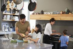 Family In Kitchen Making Morning Breakfast Together Royalty Free Stock Photo