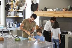 Family In Kitchen Making Morning Breakfast Together Royalty Free Stock Photos