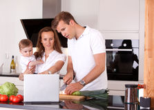 Family in Kitchen Preparing Meal Stock Photography