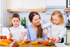Family at kitchen Royalty Free Stock Images