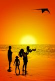 Family and a kite. Happy family on the beach Royalty Free Stock Image