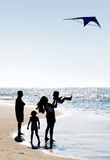 Family and a kite royalty free stock photos