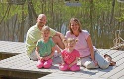 Family at the Lake. Family of Four Having Fun at the Lake Stock Image