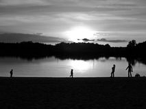 Family on the lake. Two young boys and  women on the lake, sunset Stock Photography
