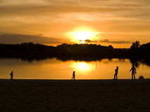 Family on the lake. Two young boys and  women on the lake, sunset Royalty Free Stock Photo