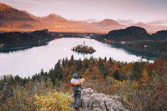 Family on the Lake Bled, Slovenia, Europe. Father and his son looking sunset with amazing view on Bled Lake. Autumn or Winter in Slovenia, Europe. Top view on Royalty Free Stock Photography