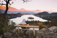 Family on the Lake Bled, Slovenia, Europe. Father and his son looking sunset with amazing view on Bled Lake. Autumn or Winter in Slovenia, Europe. Top view on Stock Photo