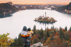 Family on the Lake Bled, Slovenia, Europe. Father and his son looking sunset with amazing view on Bled Lake. Autumn or Winter in Slovenia, Europe. Top view on Royalty Free Stock Image