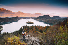 Family on the Lake Bled, Slovenia, Europe. Father and his son looking sunset with amazing view on Bled Lake. Autumn or Winter in Slovenia, Europe. Top view on Stock Images