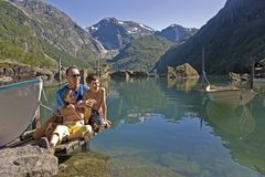 Family at the lake, in mountains Royalty Free Stock Photo
