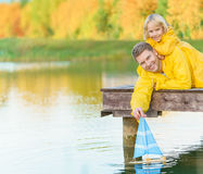 Family on a lake Royalty Free Stock Image