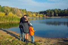 Family on lake side. father mother and son Royalty Free Stock Photo