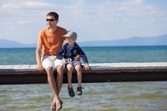 Family at lake vacation Stock Images