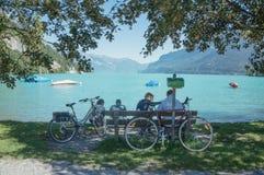 Family at lakeside interlaken. Family relaxing at interlaken of Swiss. Sunny day with beautiful lake Stock Image