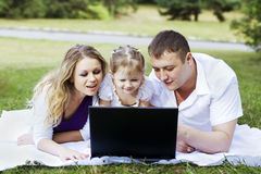 Family and laptop Royalty Free Stock Photo