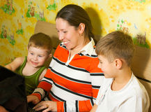 Family with a laptop Stock Image