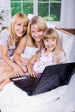 Family with laptop Royalty Free Stock Photos