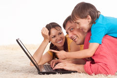 Family with laptop Royalty Free Stock Image