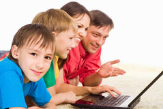 Family with laptop Stock Images
