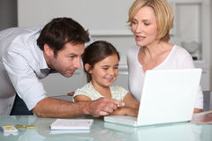 Family on laptop Royalty Free Stock Photography