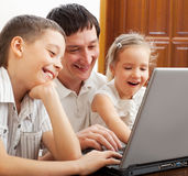 Family with laptop Royalty Free Stock Photography